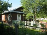Половина дома с хозяйственными посторойками и гаражем в Кобрине